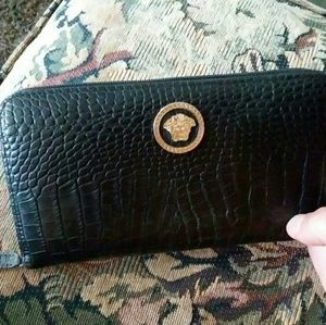 Black zip around Versace wallet(Cash not included)